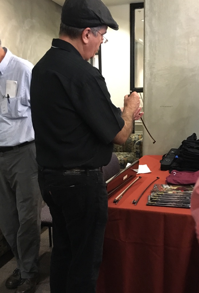 AFVBM member looks at a display of Pajeot bows.