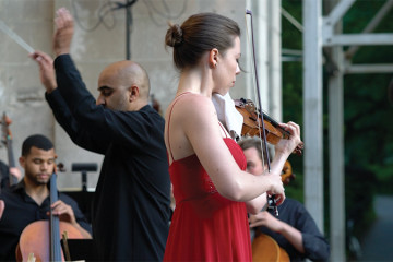 Violinist Tessa Lark performs John Corigliano's the Red Violin: Suite in Central Park, New York