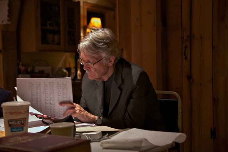 Composer John Harbison writing notations