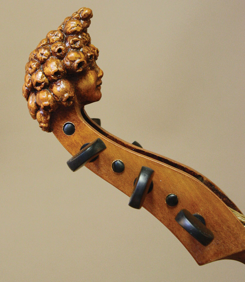 Head of 2018 treble viol with muscari botryoides (grape hyacinth); Gesina Liedmeier model